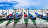Gondolas moored by San Marco square with San Giorgio di Maggiore church in the background, Venice — Stock Photo