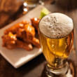 Beer and chicken wings close up — Stock Photo