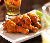 Beer and chicken wings — Stock Photo