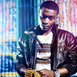 Black youth with jacket and colorful lights - Photo