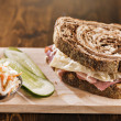Reuben sandwich with kosher dill pickle and coleslaw — Stock Photo