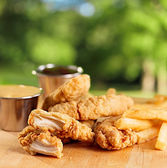Fried chicken strips with french fries and sauce. — Stock Photo