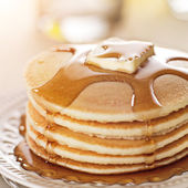 Breakfast food - stack of pancakes with syrup and butter — Stock Photo