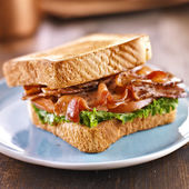 BLT bacon lettuce tomato sandwich with toast off to the side. — Stock Photo