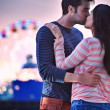 Young couple kissing near santa monica pier — Stock Photo #32670187
