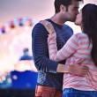 Young couple kissing near santa monica pier — Stock Photo
