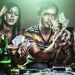 Teens at party gambling and doing drugs — Stock Photo