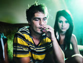 Smoking a joint at party — Stock Photo