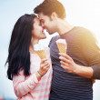 Romantic couple with ice cream at amusement park — Stock Photo