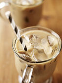 Iced coffee with black striped paper straw — Foto Stock