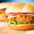Crispy chicken sandwich with bacon close up — Stock Photo #39595827