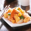 Chinese sweet and sour chicken with chopsticks — Stock Photo #39598221