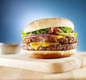 Double cheese burger with bacon — Stock Photo