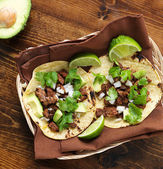 Overhead view of two traditional tacos in a basket. — Stock Photo