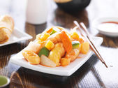 Chinese sweet and sour chicken with chopsticks — Stock Photo
