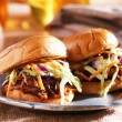 Pulled pork sandwiches with bbq sauce and slaw — Stock Photo #46871039