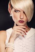 Closeup portrait of beautiful blond woman — Stock Photo