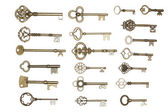 Golden keys isolated on white — Zdjęcie stockowe