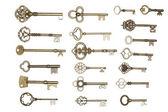золотые ключи, изолированные на белом — Стоковое фото