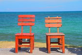 Two chairs by the beach shore. — 图库照片
