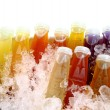 Stock Photo: Color bottles on ice, clipping path.