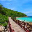 Jetty to a tropical beach on island — Stock Photo