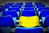 A yellow vip seat in football stadium — Stock Photo