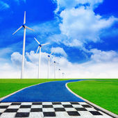 Track with wind turbines generating electricity — Stock Photo