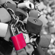 Many padlocks on the bridge — Stock Photo #33202651