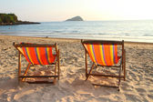 Twin deck chairs on the beach — Stock Photo