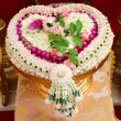 Thai flower heart shaped garland on golden tray with pedestal — Stock Photo