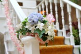 Flowers arrangement on the railing — Stock Photo