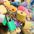 Many padlocks on the bridge — Stock Photo