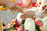 Hands pouring blessing water into bride's bands — ストック写真