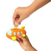 Young hand putting money into saving plane, finance theme — Fotografia Stock