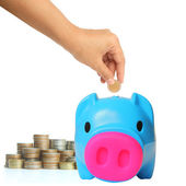 Young hand putting money into saving pig, finance theme — Stock Photo