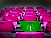 Many magenta and green 1st seat, winner concept. — Stock Photo