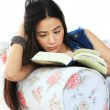 Tired young woman reading a book at home on sofa. — Stock Photo #47690485