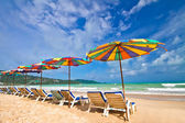 Beach chairs and colorful umbrella on the beach — Stock Photo