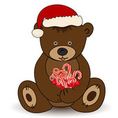 Bear in Santa Claus hat holding a candy — Vettoriale Stock