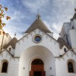 Chirch in Alberobello - Trulli village - Stock Photo