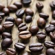 Coffee beans on the vintage wooden background - Stock Photo