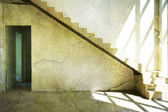 Room with stairs and light from the window — Stock Photo