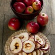 Dried and fresh ripe apples on rustic kitchen table — Stock Photo