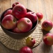 Apples on a rustic kitchen table at morning light — Stock Photo