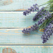 Stock Photo: Flowers on vintage wood background
