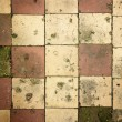 Grunge background of cracked tiles — Stock Photo