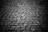 Dark paving stone roadway — Foto de Stock