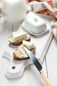 Slice of bread with cream cheese for breakfast — Stock Photo