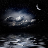 Night sky stars reflecting in sea — Stock Photo